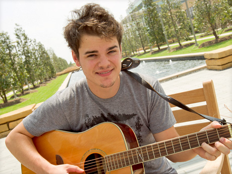 student playing the guitar